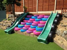 After. Tyre steps topped with artificial grass, 2 x slides & black tyres to. After. Tyre steps topped with artificial grass, 2 x slides & black tyres to create safety boundary from rockery. Kids Outdoor Play, Outdoor Play Areas, Kids Play Area, Backyard For Kids, Diy For Kids, Diy Playground, Children Playground, Tire Steps, Play Spaces