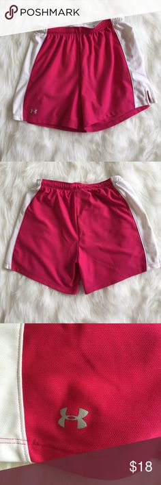 Under Armour Shorts Pink and white athletic shorts from Under Armour. Stretchy waist, drawstring inside. Inseam measures 5 inches. Under Armour Shorts