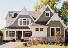 The siding is James Hardi Khaki Brown and the metal roofing is architectural Dark Bronze. White trim paint color is White Down OC-131. Summit Signature Homes, Inc.