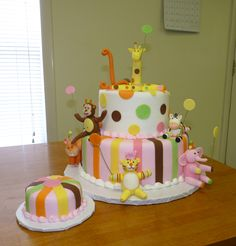 Sweet Safari 1st Birthday - Butter cake iced in buttercream.  Stripes, dots, number and animals are fondant.  Thanks for looking.