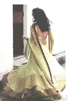 Gold, cream, and brown lengha by Priyal Prakash