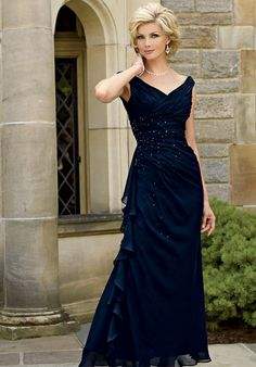 Dress features beading. Also available in petite sizes 0 to 34.