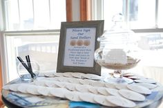 Signed sand dollars for a beach wedding!Check out our blog for some inspirational tips about Guest Books on justbethebride.com!