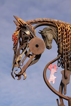 'Horse Within a Horse' Hybrid Metal Art - by John Lopez;   Closeup of a sculpture that has a bronze horse head in it.  This piece is now in Paige, Texas.