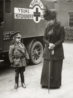 Dowager Queen Alexandra of Great Britain and a little girl in uniform, called Jeannie. C 1916.