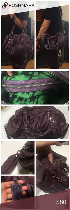 Marc by Marc Jacobs Handbag This bag was used A LOT as u can see the dark purple color has gotten much lighter all around the bag! But the bag is still in working condition.. The color is a deep purple with silver.. The inside is green and black fabric (shown in the pic) and has one zipper pocket and two other ones.. It does come with a white dust bag.. It has a shoulder strap.. When the bag sits since its leather n been used for a while it just falls (when empty). The bag is a medium size…