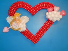 Cupid in the Clouds, Valentine's Day piece, made by Patricia Balloona. http://patriciaballoona.wordpress.com/2014/02/15/318nth-balloon-sculpture-cupid-in-the-clounds-giant-heart/