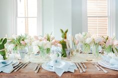 "A Sophisticated Easter Table Inspired By The Colors Of Spring as featured on Veranda | calder clark© | @ccolcolo | @blossomsevents | @verandamag | Picking a binary color palette is a surefire trick for a beautiful spread. One trick deployed here is the use of the cooler tones of powder blue and celery green paired with a warm punch of peach, allowing the flowers to be the ""oomph."""