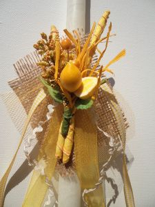 Greek Easter candle (lambada) in white and lemon colors.