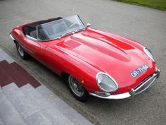 1966 Jaguar E-Type 4.2 OTS.  This is it! Red, chrome wires and black upholstery.  I'll take it, wrap it up.