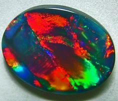 Australian Black-Opal found in the mines of White Cliffs and Lightning Ridge, NSW, Australia.