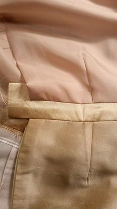 Do you hate hand stitching? Learn a new technique for sewing a waistband to a lined skirt so it looks finished on the outside and underside of the garment. This method requires little-to-no hand stitching and produces a finished waistband that looks great inside and out.