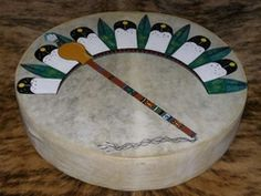 Hand painted drum made by the Tarahumara Indians. Features a Native American church style painted fan and gourd rattle.