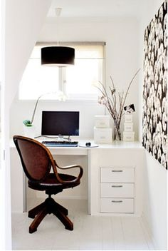 A simple clean home office can fit in a well designed space like this one.  The almost white walls really bring it together.