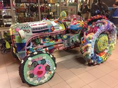 A knitted tractor in a Finnish petrol station
