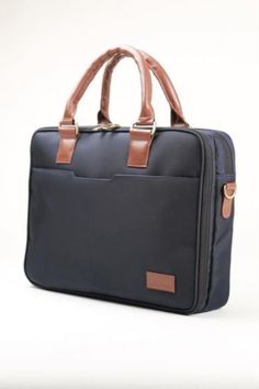 It's time to invest in yourself! This blue leather/fabric briefcase is perfect for those who are willing to create their own personal identity. Available at: www.inmoleatherbags.com    briefcase for men modern mens fashion, briefcase women laptop bags business, canvas messenger bag men, briefcase for men business luxury, business briefcase men vintage.   #INMO #Briefcase #Portfolio #MessengerBag #Office #CanvasMessenger Canvas Messenger Bag, Messenger Bag Men, Leather Fabric, Leather Bag, Business Canvas, Briefcase Women, Modern Mens Fashion, Business Briefcase, Personal Identity