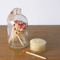 reclaimed apothecary jars transformed into a display-worthy storage for matches - and best of all, each bottle has been hand-etched to create a strike-able surface.