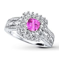 This eye-catching ring for her showcases a cushion-cut lab-created pink sapphire as a vivid counterpoint to a frame of round lab-created white sapphires. More round and square-cut lab-created white sapphires decorate the sterling silver band with magnificent sparkle.  Size 8 pls