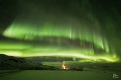 Aurora borealis over a geothermal area near Myvatn   by MarKus Fotos