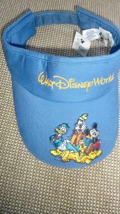 1039a74cdc8 Walt Disney World Kids Youth sun visor blue yellow donald goofy mickey  pluto hat