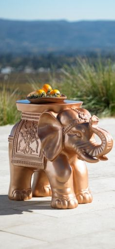 The elephant's trunk reaches up for good luck so you can set down your cocktail glass for safe keeping. This whimsical elephant table makes a perfect perch for eyeglasses, wine glasses or an hors d'oeuvres plate.
