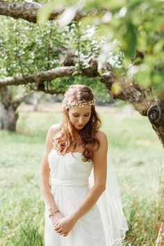 So gorgeous! The bride in a flowy white dress with a floral wreath #wedding #bride #dress #chic #flowers