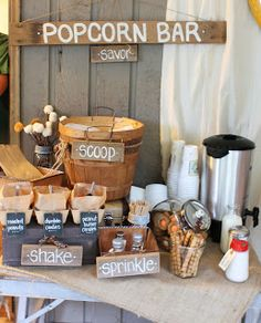 A Popcorn Bar! Such a fantastic idea. Love any kind of bar or buffet where guests can customize-- takes something as easy unfussy as popcorn and elevates it. Peanuts candies as add-ins, various seasonings. And who doesnt love popcorn?