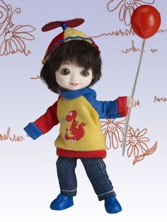 Play Time Hamish - Shipping 02/02 | Wilde Imagination - Play time:  The best part of the day!  And Hamish is ready, arriving with changeable green grey eyes, a removable wig of a deep mink hue, and his color block sweater with dragon detail over blue jeans and rick rack trimmed propeller hat!  Play time is complete with a red balloon - it doesn't get any more playful than that!