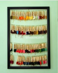 Photo by Marie Tretiakova   How wonderful is this? Functional and  pretty at the same time. Marie Tretiakova organises her floss on clothe...