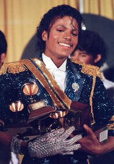 "At the 1984 Grammy Awards, no artist could keep up with Jackson, who broke a record by taking home eight awards, including album of the year for ""Thriller."""