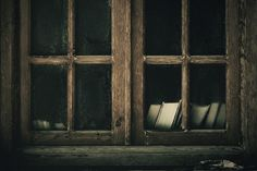 old window with books...