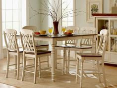 Brand new white and cherry pub table with four chairs and a butterfly leaf. Only $649!