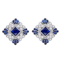 Square-shaped sapphire and diamond stud earrings, centering on a larger square-cut sapphire surrounded by circular-cut diamonds and calibre-cut sapphires, the sapphires weighing approximately 1.03 total carats and diamonds weighing approximately 0.29 total carats, mounted in 18k white gold, with posts and friction backs, designed by Lucie Campbell. Dimensions: 11mm x 11mm. 21st century