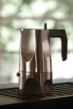"Fully aware of an object's narrative ability, Sicilian architect Mario Trimarchi has designed the ""Ossidiana"" espresso coffee maker. Like his other projects, this one is based on memories and fragments of images, told through the form of an article."