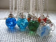 Baked marble necklaces. Toss marbles in oven for 20 minutes at 400 degrees. As soon as you remove them, carefully place in a bowl of ice water - they crack on the inside instantly. Glue on a cap bead & done!