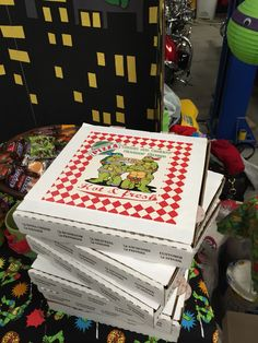 Tmnt party favors. Custom pizza box labels from etsy. I purchased boxes from a local pizzeria and filled each box with various favors for the kids.