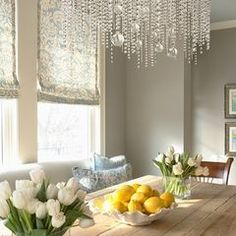 love the table, colors, gray wall, & chandelier