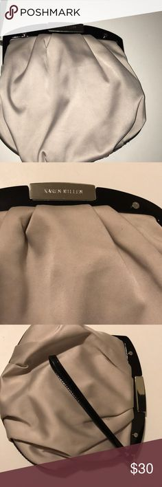 Karen Mullen evening bag Light tau satin bag. Trimmed in black patent leather. Silver tone pop lock. One strap. No shoulder strap. Too black lacquer rim. With silver tone signature studs. Zip pocket inside signature clean lining. Very classy & pretty Karen Millen Bags Clutches & Wristlets