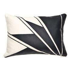 Leather applique pillow with an Art Deco design.