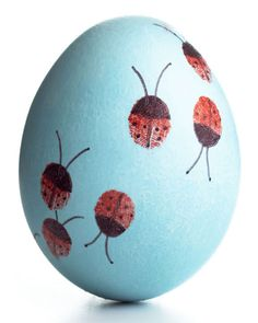 Finger-Painted ladybugs.... maybe incorporate Nathan into this year's Easter egg this way?