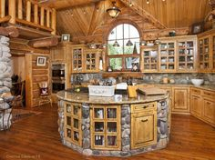 Dream Kitchen in a Log Home..generally, I don't care for so much wood inside but I really like the look of this.