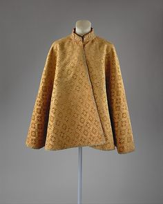 Cape, French, second half of the 16th century. This mantle, made with a sixteenth-century Ming Dynasty velvet, is purely European in form. The gold thread is typically Chinese in style: gilded paper wound on a core of orange silk.