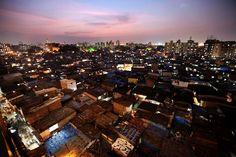The Dharavi slum in Mumbai, at twilight Photograph: Rajanish Kakade/AP