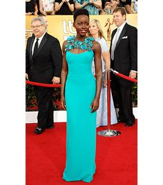 @Who What Wear - Gucci                 To accept the Best Supporting Actress statue at the Screen Actors Guild Awards, Nyong'o chose a custom-made turquoise Gucci gown with an intricate floral neckline. She wisely kept her Fred Leighton jewelry minimal, so as not to compete with the bold neckline.