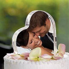 Wedding Cake Topper- Heart shaped (Or another shape) glass (Can find at Hobby Lobby or any craft store) Get a picture of the two of you (engagement pic, etc...) and use mod-podge to attach the picture on. Cute! and you can display it in your home after the wedding.