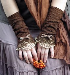 Miss Eyre - crocheted open work lacy romantic fall fasion  wrist warmers cuffs in brown and beige. $35.00, via Etsy. These are SO pretty!