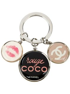 You can't have a primped car and a busted up key ring. Coco to the rescue. CHANEL VINTAGE Logo Key Ring at farfetch.com