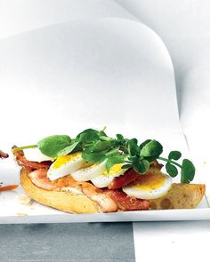 A sliced hard-boiled egg, crispy bacon, and peppery watercress top off this open-faced take on a breakfast sandwich.Recipe: Open-Faced Egg, Bacon, and Watercress Sandwich Watercress Recipes, Croissant, Breakfast Sandwich Recipes, Bacon Sandwich, Breakfast Ideas, Breakfast Healthy, Health Breakfast, Ideas Sándwich, Gourmet