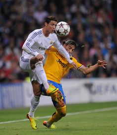 Cristiano Ronaldo fights for the ball against Martín Cáceres during the UEFA Champions League group B match between Real Madrid CF and Juventus at Estadio Santiago Bernabéu on October 23, 2013 in Madrid, Spain.