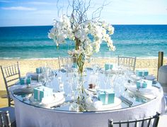 white beach Orchid center piece with shades of blue  centerpiece